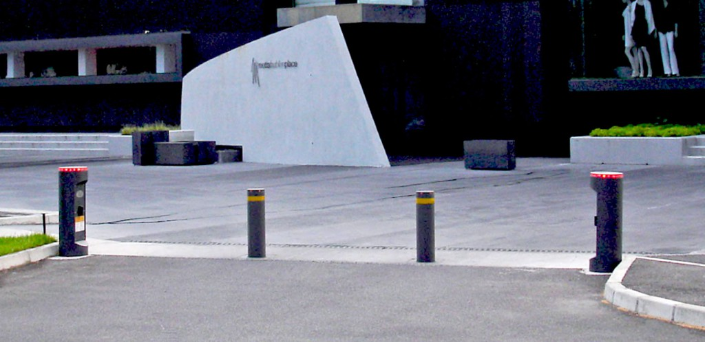 A typical installation of two AMP 1000 bollards operating together, with control gear contained within the single height Totem units with integral LED traffic lights.